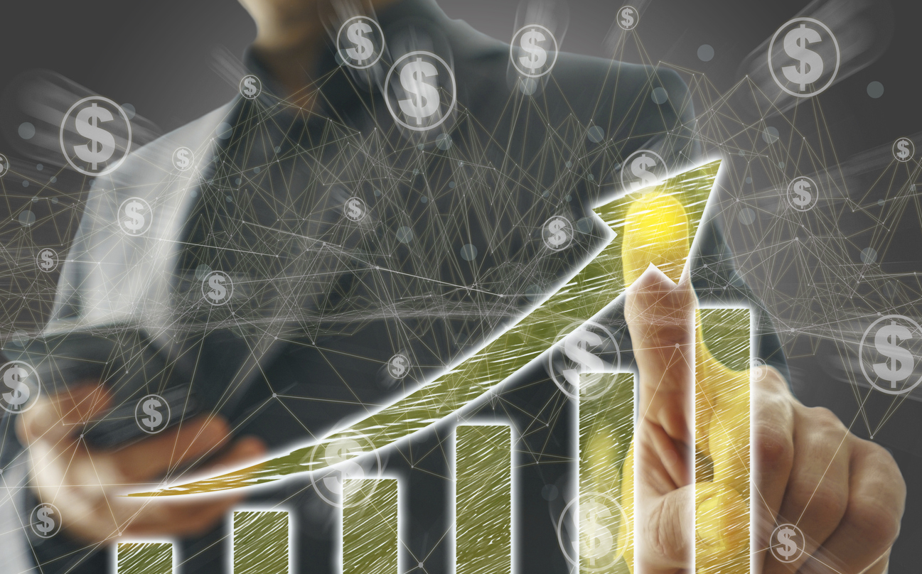 man pointing to a drawing of a graph with dollar signs to indicate business growth