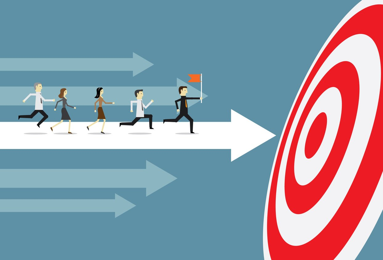 employees running toward a target using a points system